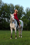 Fashionable portrait of a beautiful young woman and horse Stock Photos
