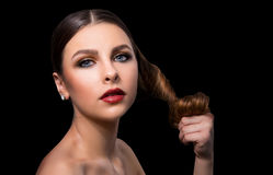 Fashionable portrait of a girl model. Fashion, accessories, evening  wet effect makeup. Royalty Free Stock Photo