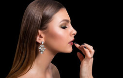 Fashionable portrait of a girl model. Fashion, accessories, evening  wet effect makeup. Stock Photography