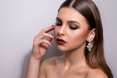 Fashionable portrait of a girl model. Fashion, accessories, evening  wet effect makeup. Royalty Free Stock Images