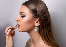 Fashionable portrait of a girl model. Fashion, accessories, evening  wet effect makeup. Stock Image