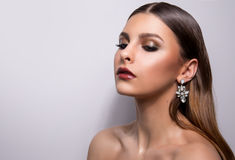 Fashionable portrait of a girl model. Fashion, accessories, evening  wet effect makeup. Stock Photo