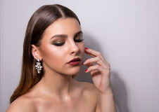 Fashionable portrait of a girl model. Fashion, accessories, evening  wet effect makeup. Royalty Free Stock Photography