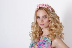 Fashionable portrait shot of beautiful sexy girl cute blonde with curly hair wearing wreath flowers handmade Royalty Free Stock Photography