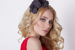 Fashionable portrait shot beautiful girl in cute blonde with curly hair wearing a wreath of flowers handmade Stock Photography