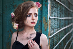 Fashionable portrait of a tearful girl with dry flowers. Retro s Stock Images
