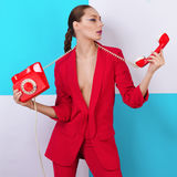 Fashionable portrait young sexy woman woman. With phone in hand Stock Photos