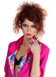 Fashionable pose. Fashionable young g lady posing in a pink blazer jacket Royalty Free Stock Image