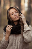 Fashionable,posing,stunning,attractive and very sensual,beautiful girl with closed elegant finders near the perfect face,pure skin Royalty Free Stock Photo