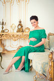 Fashionable pregnancy. Stock Photos