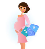A fashionable pregnant woman in pink with shopping Stock Photography