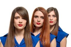 Fashionable pretty triplets Stock Photography