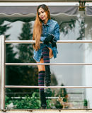 Fashionable pretty young woman wearing striped knee socks Royalty Free Stock Photos