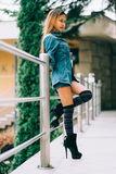 Fashionable pretty young woman wearing striped knee socks Royalty Free Stock Images