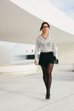 Fashionable professional woman walking outside Stock Image
