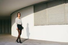 Fashionable professional woman walking outside Stock Photography