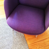 Fashionable purple armchair on wooden floor Stock Photography