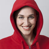 Fashionable radiant 20s girl wearing a hoodie on for coolness Royalty Free Stock Photo