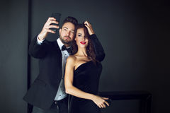 Fashionable rich celebrity couple taking selfie Stock Images
