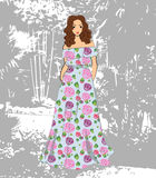 Fashionable romantic girl in floral maxi dress Stock Photos