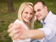 Fashionable romantic young couple outdoors. Stock Image