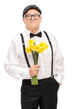 Fashionable senior holding a bunch of yellow tulips Royalty Free Stock Photography