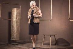 Fashionable senior woman posing. Stock Image