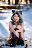 Fashionable sexy blonde woman posing outdoor in wintertime Royalty Free Stock Photography
