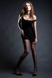 Fashionable sexy girl in short black dress Royalty Free Stock Photos