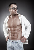 Fashionable sexy man wearing an unbuttoned shirt and eyeglasses Stock Images