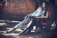 Fashionable woman. Denim style. Sexual young woman posing in jeans clothes on a street. Beauty, fashionable look. Boho style clothes and accessories stock images
