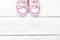 Fashionable shoes for little girls on white wooden  background. Royalty Free Stock Image