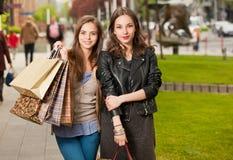 Fashionable shopping beauties. Stock Photo