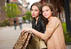 Fashionable shopping beauties. Royalty Free Stock Photography