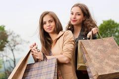 Fashionable shopping beauties. Royalty Free Stock Photo