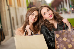 Fashionable shopping beauties. Royalty Free Stock Images