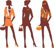 Fashionable silhouettes. Three female silhouettes in different clothes Stock Photos