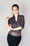 Fashionable slender brunette. Stock Photography