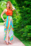 Fashionable slim woman in a bright dress Royalty Free Stock Images