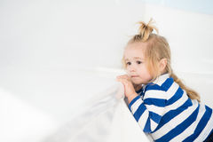 Fashionable small baby boy on white yacht in marine shirt Royalty Free Stock Image