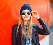 Fashionable smiling woman wearing a rock black style Stock Photography