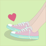 Fashionable sneakers and heart. Pink fashionable sneakers and heart royalty free illustration