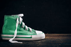 Fashionable sneakers on wooden background Stock Photo