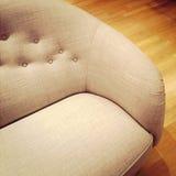 Fashionable sofa on wooden floor Stock Photography