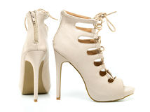 Fashionable stiletto high heels ankle boots. In nude colour with laces, open toe and stiletto heel Stock Photos
