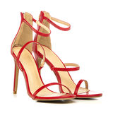 Fashionable strappy high heels sandals in red Stock Image