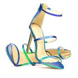 Fashionable strappy high heels sandals in shiny metallic colors. Sexy high heels sandals in shiny metallic animal priint design Royalty Free Stock Photo