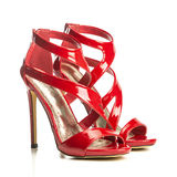 Fashionable strappy high heels sandals in shiny red Royalty Free Stock Image