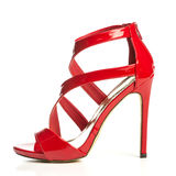 Fashionable strappy high heels sandals in shiny red Stock Images