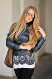 Fashionable woman with handbag wearing sunglasses Royalty Free Stock Images